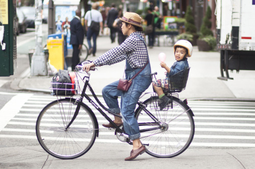 Cute mother and son biking in denim