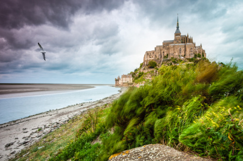 """Mont Saint-Michel at windy stormy day"" by Konstantin Yolshin"