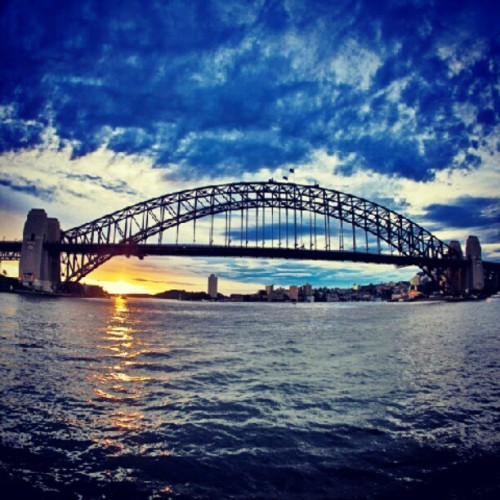 #sydney harbor #bridge #sunset #light #australia #travel #water #architecture #design #instamood #instalondon #instaphoto #cloudporn #clouds #skyporn #sky  (Taken with Instagram)