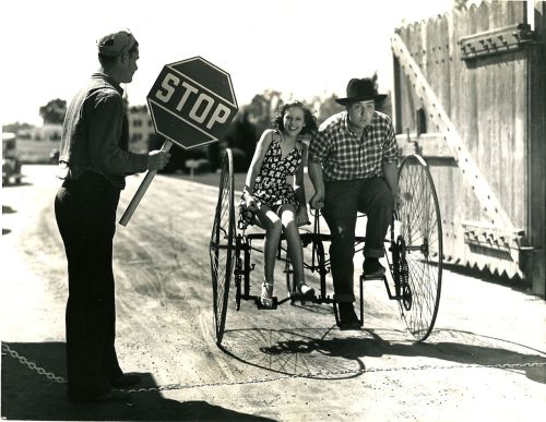 ridesabike:  Lynn Roberts and Smiley Burnette ride a society bike.