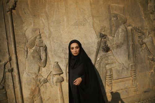 "wanderlustintraining:  Persia: Ancient Soul of Iran A glorious past inspires a conflicted nation. Photograph by Marguerite Del Giudice  (Newsha Tavakolian, National Geographic) What's so striking about the ruins of Persepolis in southern Iran, an ancient capital of the Persian Empire that was burned down after being conquered by Alexander the Great, is the absence of violent imagery on what's left of its stone walls. Among the carvings there are soldiers, but they're not fighting; there are weapons, but they're not drawn. Mainly you see emblems suggesting that something humane went on here instead—people of different nations gathering peace­fully, bearing gifts, draping their hands amiably on one another's shoulders. In an era noted for its barbarity, Persepolis, it seems, was a relatively cosmopolitan place—and for many Iranians today its ruins are a breathtaking reminder of who their Persian ancestors were and what they did. The recorded history of the country itself spans some 2,500 years, culminating in today's Islamic Republic of Iran, formed in 1979 after a revolution inspired in part by conservative clerics cast out the Western-backed shah. It's argu­ably the world's first modern constitutional theocracy and a grand experiment: Can a country be run effectively by holy men imposing an extreme version of Islam on a people soaked in such a rich Persian past? Persia was a conquering empire but also regarded in some ways as one of the more glorious and benevolent civilizations of antiquity, and I wondered how strongly people might still identify with the part of their history that's illustrated in those surviving friezes. So I set out to explore what ""Persian"" means to Iranians, who at the time of my two visits last year were being shunned by the international community, their culture demonized in Western cinema, and their leaders cast, in an escalating war of words with Washington, D.C., as menacing would-be terrorists out to build the bomb…  Continue reading the main story…"