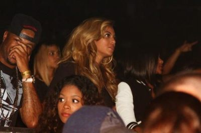 Beyoncé [sitting with The-Dream] at her husband Jay-Z's first night performance at the Barclay's Center last night