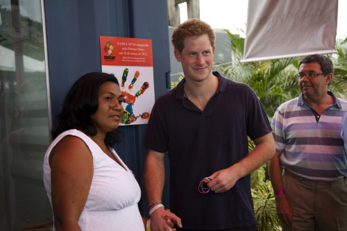 gingerprinceharry:  Look at harry's hand lol  That's the woman he should Marry…keep him out of trouble…frisky cub ;->