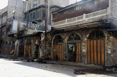 tiffehr:  Fire Sweeps Through Aleppo's 17th-Century Souk of Aleppo - NYTimes.com For many residents, the old city, with the souk at its center, is the soul of Aleppo, one of the world's oldest continuously inhabited cities and Syria's largest. Aleppo has been staggering for months under a bloody battle that has reduced some residential areas to rubble, and with no deaths immediately reported from the blaze, the damage to the souk pales compared with the recent human toll. Yet serious damage to an area that Syrians widely consider one of their greatest treasures is likely to stir anger at both sides — each of which blames the other for the destruction in the city — in a conflict that seems mired in stalemate. It could also make the rebels' latest push in Aleppo backfire politically: Some opponents of President Bashar al-Assad were already incensed on Saturday at insurgents they said had operated conspicuously near the old city.  Image from al Jazeera, which has more extensive information and sources.  The central souk (market) was the main reason I wanted to visit Aleppo last year during my trip around the world. @tiffehr and I arrived about a month after the uprising started and found the souk, as well as the rest of the city, almost completely devoid of tourists (normally a thrilling prospect, but unsettling in this case). We spent a couple of days wandering the dark corridors of the ancient market, inhaling spices, meeting friendly shopkeepers and gawking at over-the-top bridal gowns. It was the heart and soul of Aleppo's old town and one of the most intoxicating places I've ever had the fortune to visit. Seeing these images makes my heart sink.