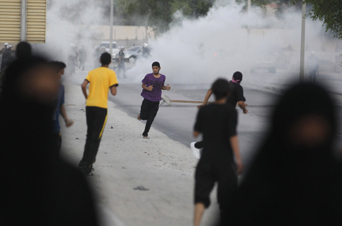 "Bahraini teenager killed in protest  Seventeen-year-old dies after police fire shotgun pellets at anti-government rally in Manama on Friday.  Bahraini riot police have killed a teenager when they fired shotgun pellets during clashes with protesters in the country's capital, Manama, on Friday, the country's opposition said.The teenager is the second young protester to die in Bahrain in six weeks.Thousands rallied on Friday in an officially authorised protest called by the main opposition group al-Wefaq, but as the event ended around 100 demonstrators clashed with police.Witnesses said riot police used tear gas and stun grenades to disperse those demonstrators, who, the authorities said, were throwing petrol bombs and wielding iron bars.The police described the incident after the protest as a ""terrorist attack"" on a security patrol that ""targeted the lives of members of the patrol"" late on Friday evening.The police had defended themselves ""according to their legal authority"", a statement said on Saturday, confirming one of the protesters had died.Mass demonstrationsBahrain, headquarters of the US Navy's Fifth Fleet, has been in turmoil since mass demonstrations started at the heightof Arab Spring unrest last year, led by its Shia Muslim majority.The protests were put down by the Sunni monarchy which imposed martial law and invited Saudi Arabia to send troops insupport.In mid-August, a 16-year-old protester was killed in a similar incident, when police opened fire with birdshot during clashes after a demonstration, opposition activists said.The opposition says more than 45 people have been killed in protests since martial law was lifted in June 2011. The Interior Ministry says protesters have injured more than 700 police officers and that the authorities have exercised restraint.Al-Wefaq named the dead protester as 17-year-old Ali Hussain Nima and distributed photographs showing a body covered in blood and flecked with birdshot wounds. The pictures could not be independently verified.Bahrain and Saudi Arabia accuse Iran of fomenting the unrest in the island kingdom and among Saudi Arabia's Shia Muslim minority, who mostly live in a province situated next to Bahrain. Iran denies the accusations. The death comes a day after the UN Human Rights Council appointed a Bahraini as the Asia representative to its advisory committee."