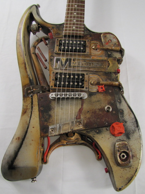 MOD-U-LINE Relic guitar                                                                          I don't think this electric guitar is harmful to living creatures. The Russian, Ivan S., constructed it to look similar to American guitars, but only had grainy B & W photos for reference. He inadvertently used parts and metal pirated from electronic equipment from the Chernobyl power plant after the meltdown in 1986. Playing it, he developed odd blisters on his fingers and a nagging cough. It was sold soon after his death by his Mother who was raising cash for a trip to Poland to scatter her Mother's ashes. The guitar's history between then and 2004 is unexplained. I bought the guitar in the parking lot at the 2004 NAMM show from some guy selling stuff out of his Windstar. I don't think it's still radioactive or anything. I put in a new bridge and pickups when the old ones crumbled.   Details & Pics at www.facebook.com/TonyCochranGuitars