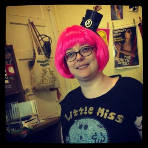 Persephone trying on her pretty pink wig and mini pirate hat! (Taken with Instagram)