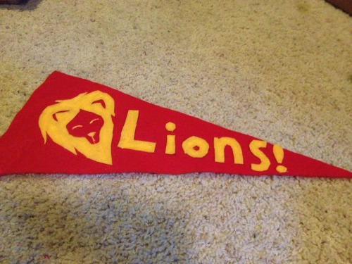 We're making pennants for the Gryffindor video.  Look how cute they are!