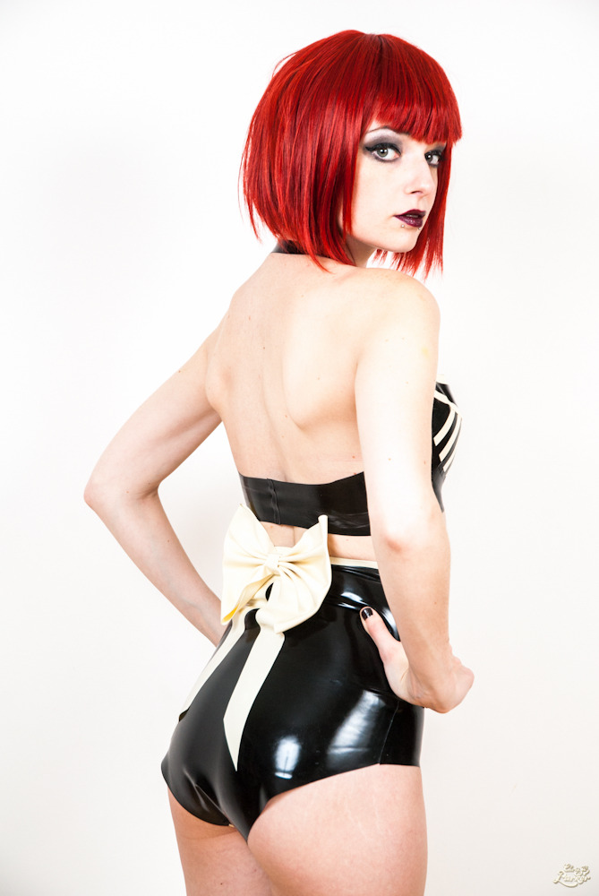 Photos: Chris W Parker www.chriswparker.co.uk Latex: Hellcat Latex Wig: Geisha Wigs Girl: http://www.facebook.com/abbiemac.altmodel