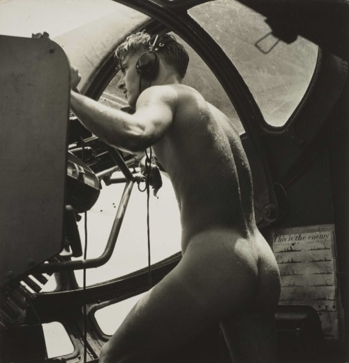 collective-history:  Naked PBY gunner mans his machine gun after a rescue ca. 1944.   …we got a call to pick up an airman who was down in the Bay. The Japanese were shooting at him from the island, and when they saw us they started shooting at us. The man who was shot down was temporarily blinded, so one of our crew stripped off his clothes and jumped in to bring him aboard. He couldn't have swam very well wearing his boots and clothes. As soon as we could, we took off. We weren't waiting around for anybody to put on formal clothes. We were being shot at and wanted to get the hell out of there. The naked man got back into his position at his gun in the blister of the plane.  Horace Bristol