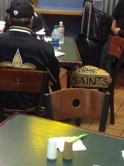 A guy in the airport has a Saints-themed cheesehead. I've got some serious fan apparel envy going on right now.
