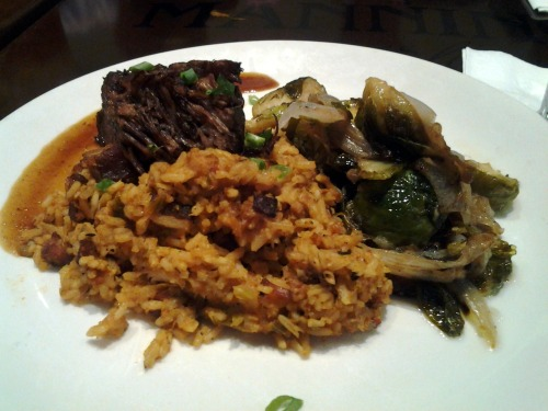 Manning's Jambalaya with Braised Short Rib. Also had brussels sprouts w/ onions. I think the jambalaya had salted pork, instead of sausage, and chicken. It was full of Southern spices and packed solid heat. The braised short rib was cooked just long enough so it was full of flavor and fell apart with the tug of the fork. The brussels sprouts were crunchy and the onions were sweet and tasty. The feeling I got from the restaurant was… weird. Sports bar TVs and noise mixed with elegant and fancy food. I guess if you order like the table next to us did— rare steaks and french fries —then it would have felt more fitting. It was difficult to have a conversation without yelling, which detracted from the experience. Service was fine and fast, though. Anyway, thanks to Ms. Cindy for bringing me along!