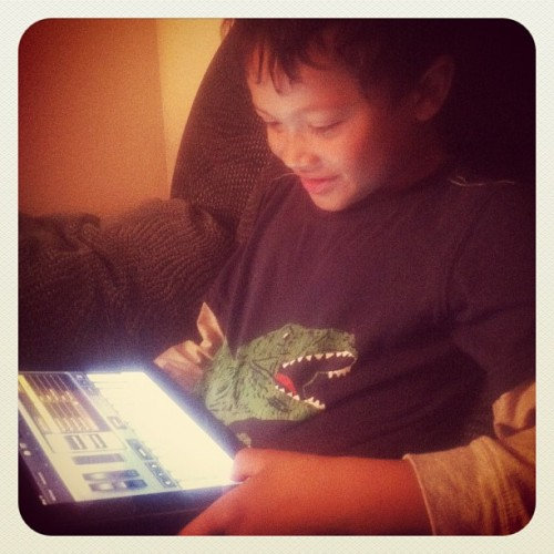 My son, playing with GarageBand. #garageband #ipad #music #compose #iphone #instahub #musiced  (Taken with Instagram)