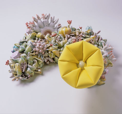 "Susan Beiner Synthetic Reality, 2005. Porcelain, polyfil, foam, 24"" x 20"" 14"""