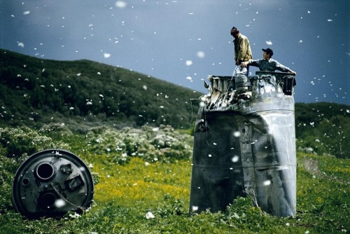 "jtotheizzoe:  ""Russia. Altai Territory. 2000. Villagers collecting scrap from a crashed spacecraft, surrounded by thousands of white butterflies."" Hard to imagine a more superbly magical photo caption than that."