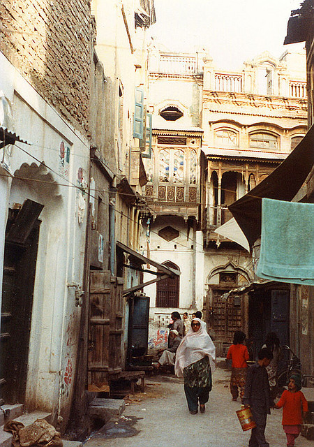 um-er:  Pindi back street by Noorkhan on Flickr.  The city streets I have always known and but then, not so much.