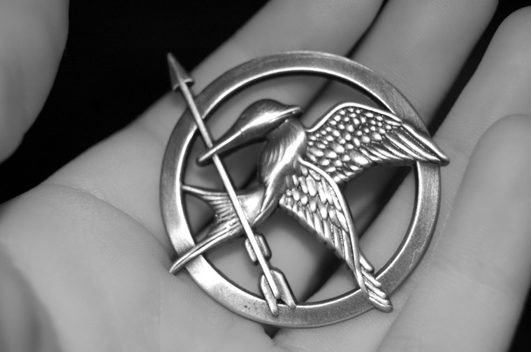 This replica mockingjay pin must be familiar to the fans of Hunger Games. It's made of metal, so it's not some cheap plastic knockoff. This pin measure 1 1/4 inches across, and it's also pretty cheap.  Price: $4.7 [Amazon]