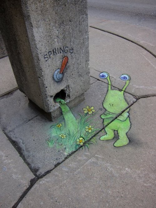 Sluggo has been appearing on sidewalks, walls and ledges since 2008, originally as a chalk drawing of a child that took a strange turn.  He has since developed a widespread reputation as a semi-subterranean jack of few trades with flexible personal architecture and a fondness for flying pigs. The Adventures of Sluggo by http://www.zinnart.com/