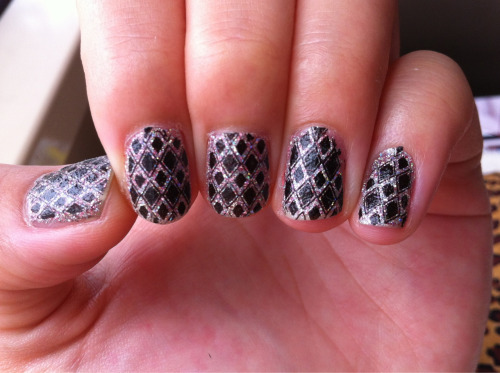 Glitter base and a stamped-on geometric pattern.