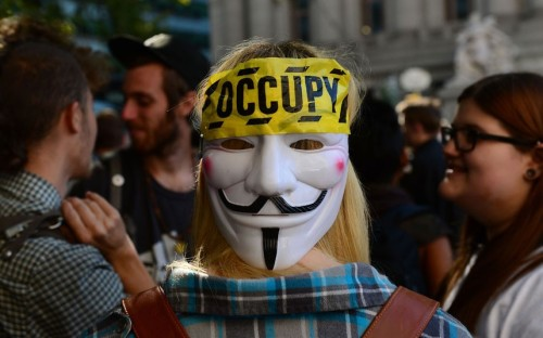 Anonymous - always there, in the background (via Occupy Wall Street protesters hold rally in New York to mark anniversary - Telegraph)