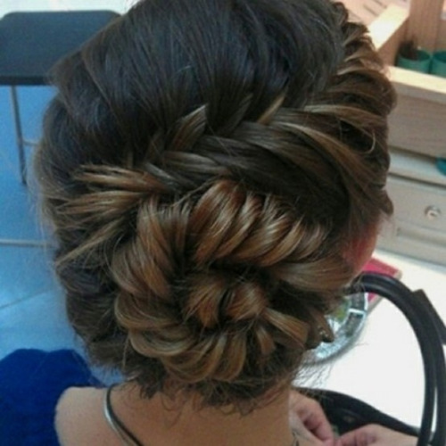 Conch Shell Braid How-To:  STEPS:  1.)   Begin this look with a great blow-dry, a go to product to use on hair before you blow dry it is Shu Uemura's Kaze Wave, a texturizing mousse that adds ample volume with texture to hair.  2.)   Once hair is fully dry, use a brush to bring hair over to one side of the head. You want to create the illusion that there is no part.   3.)   The key in beginning the braid is to start it about a half inch away from the forehead, so it's not too dramatic and tight. There should be a little bit of looseness so the look appears carefree and not severe.  4.)   For added volume, lightly tease the front of the hair where the braid's starting point is, especially if you have thinner hair. Use a fine-tooth comb and hairspray to amp up the volume.   5.)   Using the normal technique for creating a fishtail braid, begin the braid. You might want to keep a shaping cream or wax handy to aid your fingers in keeping the braid in place.  6.)   When you complete about 10 rotations of the fishtail braid, begin to coil the braid's creation to the left (think the shape of snail shell), heading towards the crown of your head. You want to make the curve noticeable, not subtle.  7.)   Finish the fishtail as normal and tie with a clear or hair-colored elastic band.  8.)   As you would create a normal bun, turn the braided ponytail around in a circular manner, also similar to a seashell's shape. When all of the hair is in a bun-like shape, take the end of the hair and pin it in or under the bun using hair-colored bobby pins. You want the finish product to appear unfastened, so every tool used to secure the look must be hidden.   9.)   To complete the look, liberally apply secure hold hairspray to make sure the style stays put whether you are headed to a dance or just a dinner date.