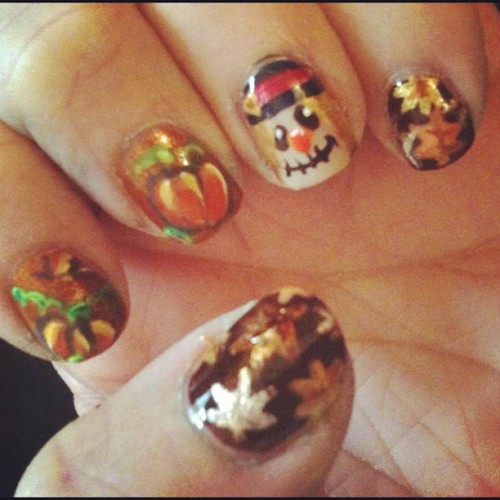 Nail art sunday with the roomie #notd #fall #nails #pumpkin #pumpkinpatch #scarecrow #leaves #gold #copper #orange #brown #warm #nailart #nailartjunkie #nailartaddict #nailpolish (Taken with Instagram)