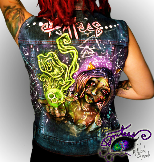 "New DMTee vest for sale :) $45. size S/M. Entire vest is gently colored with teal, purple and the collar is pink. Front is painted as well. There are pyramid studs around the ""DMTees"" at the top. Featuring a new creature of mine, I call her  Neb! There are some triangle buttons around her head as well.(this one was very hard to photograph for some reason, heres a clearer shot:https://www.facebook.com/photo.php?fbid=437202166316802&set=a.384707758232910.77564.360329580670728&type=1&theater&notif_t=like"
