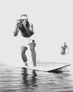 1969, California culture photographer LeRoy Grannis surfing Hermosa Beach with his Calypso amphibious camera, invented by another aquatic legend– Jacques Cousteau. Photo by John Grannis. –Photograph © LeRoy Grannis. All rights reserved.