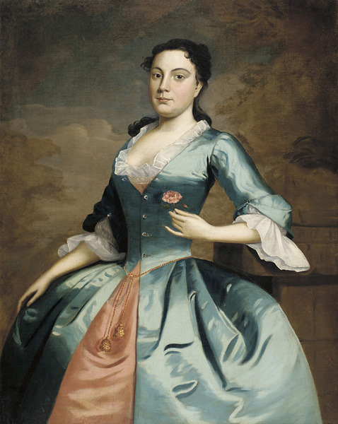 "Mary McCall by Robert Feke, ca 1746 US (Philadelphia), Pennsylvania Academy of the Fine Arts  Feke is considered the first important American-born artist.  He developed a style that was distinct from the prevalent English technique practiced in the Colonies.  This ""native style"" became popular, and Feke earned a living as an itinerant portraitist, traveling between Boston, Philadelphia, and Newport, Rhode Island.  Little is known of Feke; his later life is particularly mysterious.  After embarking from Newport in 1750, possibly bound for commissions in Barbados, he was never heard from again.  Mary McCall was a member of the Philadelphia Dancing Assembly, which hosted dances every two weeks and was a vital part of the social life of colonial Philadelphia.  She holds a single flower, a common device in Feke's portraits, in this case possibly indicating McCall's availability for marriage.  Seven years after this portrait was thought to have been painted, McCall married the merchant William Plumstead, whoserved as mayor of Philadelphia in the mid-1750's."