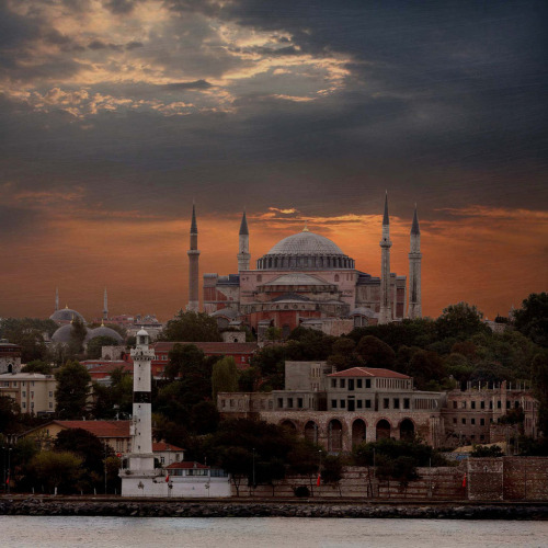 cennetvatan:  Hagia Sofia from the Golden Horn, Istanbul (by R. O. Flinn)  There's a brief scene in Argo set in Hagia Sofia, and I guess the pictures I'd seen of it until then hadn't done it justice, because I completely had my knees taken out from under me with how beautiful it is. @byzantienne, when are you taking me to Turkey?