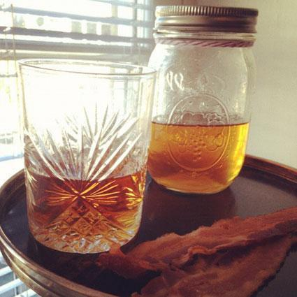 "Bacon-infused bourbon might sound a tad over the top, but the aromatic concoction is one of the most requested recipes at Restaurant August, John Besh's fine dining spot in New Orleans. And for good reason. ""The bacon really brings out a lot of the smoky, woodsy flavor of the bourbon,"" says General Manager Jeff Gulotta. Fortunately, unlike some of August's fruit-based infusions, this one is both easy to make and unaffected by the seasons. ""Bacon is year round, thank goodness,"" Gulotta jokes.  (via Restaurant August's Bacon Bourbon 