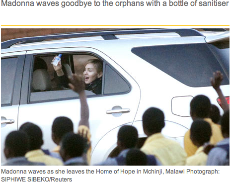 [Madonna waves goodbye to orphans in Malawi with a bottle of sanitiser]