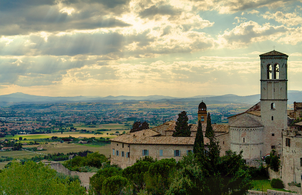 trentgilliss:  Hard not to be overly romantic about Italy when you see HDR photos of this sunset over the Basilica of Saint Francis in Assisi. Tough work writing up summaries of Krista Tippett and On Being's online activities of the week and creating a narrative… Photo by NKCPhoto/Flickr, cc by-nc-nd 2.0