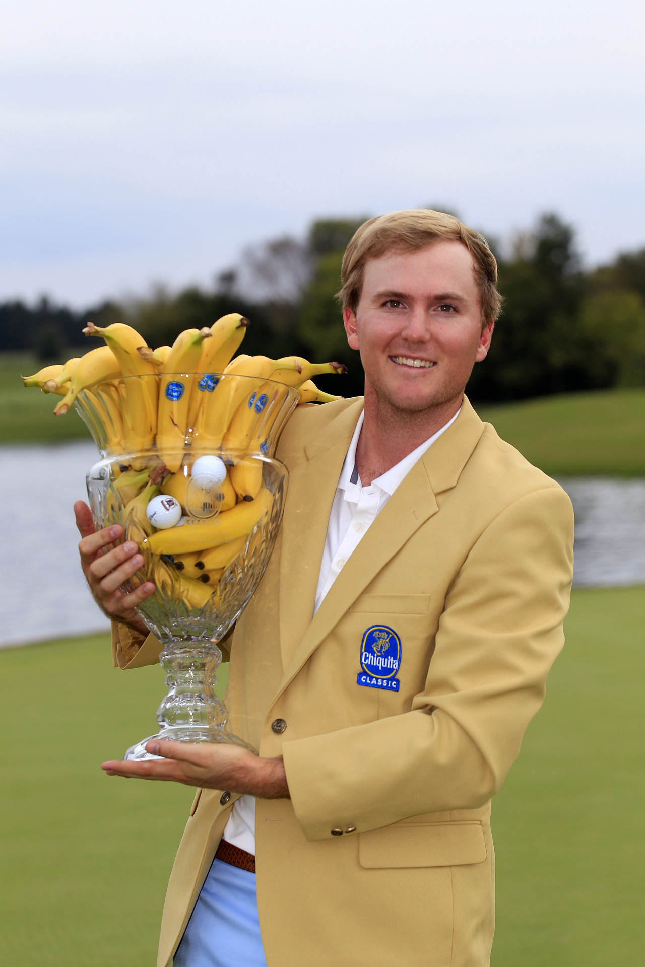 This one's for ALL THE BANANAS: Russell Henley holds the trophy after winning a one-hole playoff at the Chiquita Classic held at The Club at Longview on September 30, 2012 in Weddington, North Carolina.Photo: Michael Cohen/Getty Images