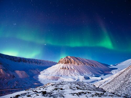 nationalgeographicmagazine:  Aurora Borealis, Svalbard Photograph by Max Edin, Your ShotI was visiting Longyearbyen, Svalbard, way up over the Arctic Circle, when I decided one clear night to go out and photograph the stars. After I made it to the location I'd chosen and had set up my exposure, the most beautiful aurora borealis show I've ever witnessed happened right overhead. The full moon at the time helped brighten up the foreground, creating this image.