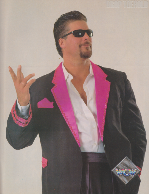 "Vinnie Vegas - WCW Magazine Collector Series Special #3 [December 1992]  ""Hey, yo — I'm always an odds-on favorite to score the pin!' Even if Vinnie Vegas didn't stand seven feet tall, his WCW debut last year at Clash of the Champions XVIII would have been impressive. The 300-pounder made quick work of veteran Thomas Rich, pinning him in under a minute following his ""snake eyes"" finisher: a devastating facedrop into the top turnbuckle. In the months since, this arrogant Las Vegas native has been testing the WCW waters in a variety of ways: solo matches, tag teams, different management. But it's likely that he has found his calling in The Vegas Connection, a formidable tag team consisting of Vegas and ""Diamond"" Dallas Page. This combination is currently giving a lot of potential tag team opponents sleepless nights. Vegas is a clear part of the energetic youth movement in WCW, but there are those who hope this massive rulebreaker won't be too successful!""  Look at that world-famous Kevin Nash smirk!"