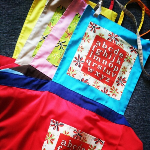 Busy packing a bunch of our brand new #alphabet #aprons for a stockist, and then these will launch in the website as soon as we make more of them! #littleoddforest #handmade #kitchen #accessories #apparel #singapore #indielabel #design #craft #vintage  (Taken with Instagram)