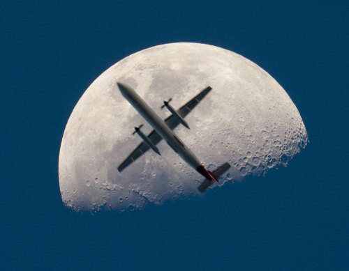 An Airplane in Front of the Moon. Via @NASA.