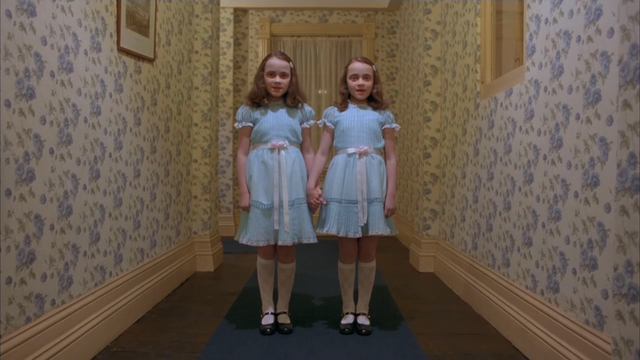 THE GRADY TWINS We might as well get on board with October and post some iconic Halloween-appropriate looks, so there you go: the Grady twins, famously inspired by this photo by the legendary Diane Arbus. The Shining (1980), directed by: Stanley Kubrick, costume design by: Milena Canonero