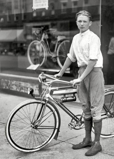 "Washington, D.C., circa 1921. ""Times boy and bicycle."" One of the winners of a Washington Times subscription-selling contest and his prize, a Mead Ranger bike.  A paper boy's prize. Or a young Daniel Craig?"