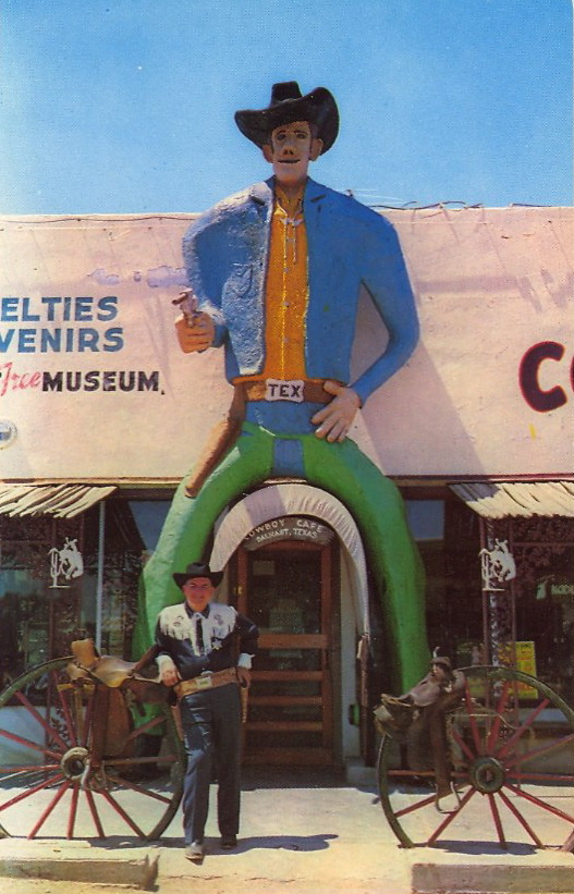ENTER UNDER THE COWBOY'S CROTCH  COWBOY CAFE A big Texas welcome awaits you at the Cowboy Cafe. Located on U.S. highways 54-87 and 385 in Dalhart, Texas. Laurence Melton, owner, invites you to see his relics of the Old West in his free museum. Cowboy Cafe is widely known for its fine food and western atmosphere.