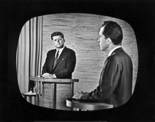 "life:  LIFE.com remembers the legendary Kennedy-Nixon debates in the fall of 1960 — and the look and feel of a contest often cited as the first ""modern"" presidential campaign. Pictured: Presidential candidate Richard M. Nixon (right) speaks during a televised debate while opponent John F. Kennedy watches, 1960."