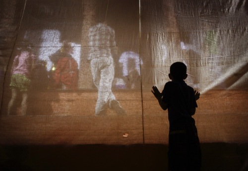 Photo of the Day: A boy is silhouetted as he looks through the curtains before performers get ready to perform a play based on Hindu mythology while celebrating the Indra Jatra festival in Kathmandu.  The annual festival, named after Indra, the Hindu god of rain and heaven, is celebrated by worshipping, rejoicing, singing, dancing and feasting in Kathmandu Valley to mark the end of monsoon season. (Photo: REUTERS/Navesh Chitrakar)