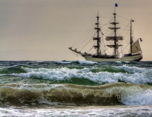 absolutescotland:  2011 Tall Ships Greenock - Europa - A life on the ocean wave by velton on Flickr.  What a beautiful vessel, elegant and redolent of adventure, exotic cargo, new lands….oh yes, I could get quite carried away.  It's Dutch I see, a surprisingly influential country historically for being a mere dot geographically.  Now please excuse me, I'm off to ride the waves…
