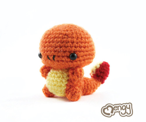 "Crocheted Fan-Amigurumi - inspired by Pokemon Eager to please, this Charmander can't wait to show off its moves to the perfect Trainer! Size: 2.75"" high x 2"" long Handmade with 100% wool, 100% cotton and cotton/modal blend yarns, filled with 100% polyester stuffing and plastic pellets (in body area only - for stabilization. Stands on its own easily). Plastic safety eyes with fasteners are used for the eyes and cotton embroidery thread is used to create the nostrils. Due to small pieces and choking hazard this item is not meant for small children $15 plus shipping (via Charmander Pokemon Amigurumi by mengy on Etsy)"