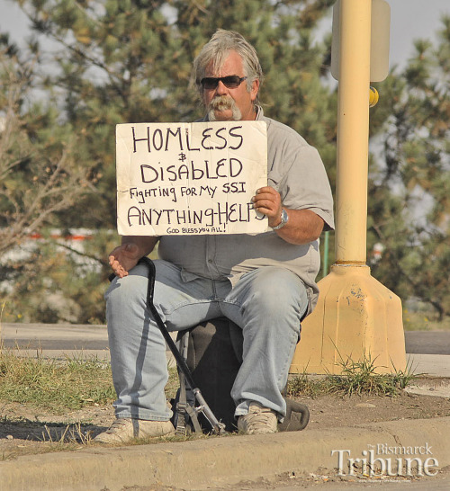Panhandler Chuck Ernest sits at the off ramp of I-94 and State Street in Bismarck on Wednesday, 9-26-2012. Ernest said he doesn't like the proposed Bismarck city ordinance prohibiting certain forms of panhandling and certain designated locations in the city. (Tom Stromme/Bismarck Tribune)