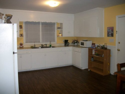 This is a picture of my kitchen. I have posted it before, but I figured you should see it again since I'm considering painting my cabinets. I was thinking about painting them a nice sage-ish green. I'm not sure how it would look though and I don't want to come to regret my decision in the color. I want it to have a country home feel, maybe I'll get some red gingham seat pads for the chairs. Not sure. What do you all think?