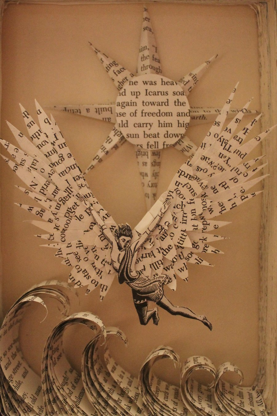 patch-22:  Icarus Book Sculpture by ~wetcanvas