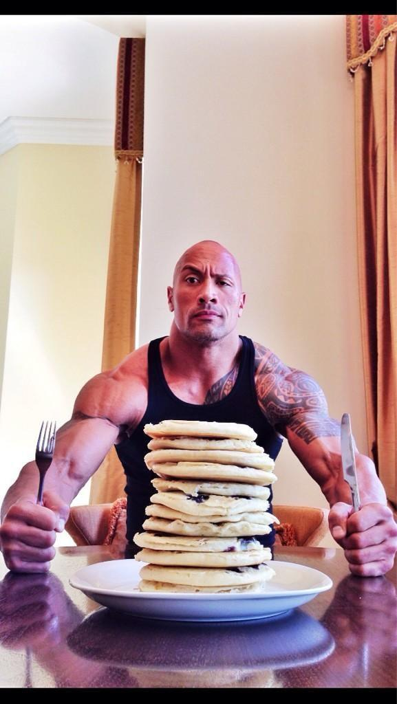 I am probably far too amused by this photo of The Rock with pancakes.