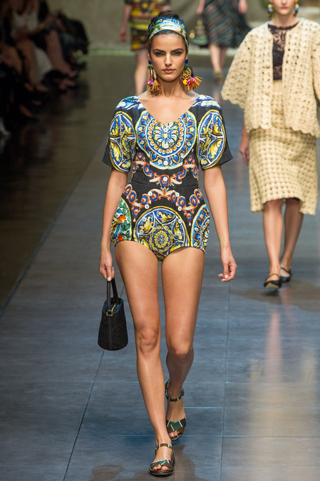 cashmereandtweed:  Dolce and Gabbana:  Spring/Summer 2013 Dolce sure does know how to present a quality line, filled with looks that sing of the colorful tradition of Italy. It is clear through the show's progression that the brand was attempting to include a representation of Italy as a whole through depicting it's different regions. The colorful coast of Amalfi, the modern aspects of Milan, agricultural production in Tuscany, aquatic presence of Venice, and the traditions of Rome. It can also be seen that a slight Cuban influence was represented. The broad stripped looks are a clear comparison to styles seen in the Caribbean resort towns and also in South America. The majority of these looks exuded an almost couture feel, having such intricate artful qualities. From the hand detailing on many of the looks from the vibrance of the colors, this collection really didn't have a low point. The model's styling was like the cherry on top of this gelato sundae. Darkened cheekbones, vibrant headbands, and long Cuban style earrings were perfect compliments to the exquisite looks sent down the runway. The definite showstoppers of this collection were the wooden bird-cage like structures that were the last looks displayed. Ranging from a beautiful brassier to a full gown, these structures can only be described as beautiful and a perfect representation of all that is Milan Fashion Week. Dolce and Gabbana did not disappoint this season. I was captivated looking through the photos from this collection, from the beautifully bright colorings to the amazing garments. As a powerhouse in the fashion world, Dolce did not disappoint…but did anyone expect anything less?  Written by Luke Hartman         Photos by Style.com